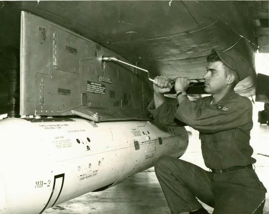Pete Byam working on an F-100 Super Sabre Jet Fighter