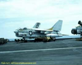 A picture of an A-7 Corsair II on the deck of the USS Kitty Hawk, CV-63