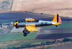 Dan Collier flies his beautifully restored vintage Ryan PT-22 Airplane over Southern California